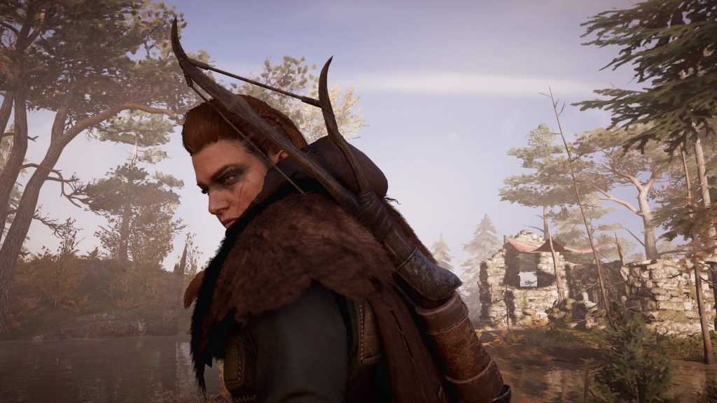 Female Eivor in Assassin's Creed Valhalla, standing in the wilderness with tattoos across her eyes and a bow on her back