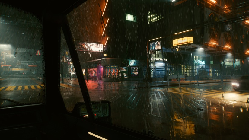 Night City on a rainy night, seen through a car window